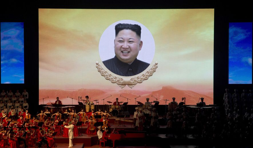 """A portrait of North Korean leader Kim Jong Un is displayed on a large screen with the words """"We will go and go along the road of loyalty, Shining Fatherland"""" during a evening gala performance on the eve of the 70th anniversary of North Korea's founding day in Pyongyang, North Korea, Saturday, Sept. 8, 2018. North Korea will be staging a major military parade, huge rallies and reviving its iconic mass games on Sunday to mark its 70th anniversary as a nation. (AP Photo/Ng Han Guan)"""
