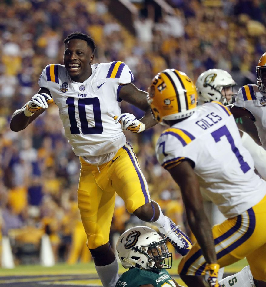 LSU wide receiver Stephen Sullivan (10) celebrates his touchdown reception to end the first half of an NCAA college football game against Southeastern Louisiana in Baton Rouge, La., Saturday, Sept. 8, 2018. (AP Photo/Gerald Herbert)