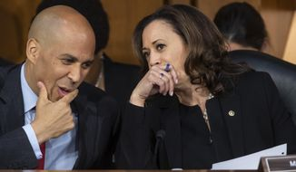 In this Sept. 6, 2018, photo, Sen. Cory Booker, D-N.J., left, and Sen. Kamala Harris, D-Calif., confer before questioning Supreme Court nominee Brett Kavanaugh as he testifies before the Senate Judiciary Committee on the third day of his confirmation hearing, on Capitol Hill in Washington. Spurred on by the left, Democrats brought fire and fury to the confirmation hearings for President Donald Trump's Supreme Court nominee, but their aggressive tactics have put at least one senator at risk of an ethics investigation. (AP Photo/J. Scott Applewhite)