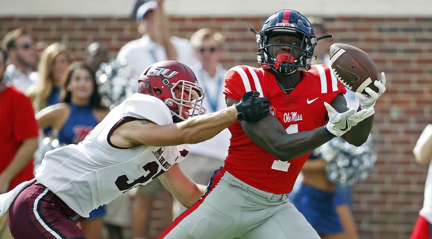 Mississippi wide receiver A.J. Brown (1) hauls in a 38-yard touchdown pass reception while Southern Illinois safety Michael Elbert (37) attempts to break up the pass during the first half of their NCAA college football game on Saturday, Sept. 8, 2018, in Oxford, Miss. (AP Photo/Rogelio V. Solis)