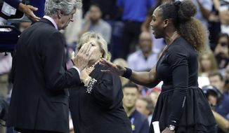 Serena Williams talks with referee Brian Earley during the women's final of the U.S. Open tennis tournament against Naomi Osaka, of Japan, Saturday, Sept. 8, 2018, in New York. (AP Photo/Julio Cortez)
