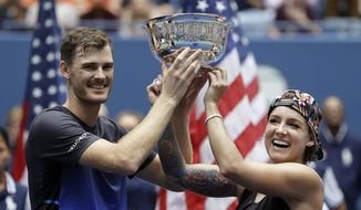 Jamie Murray, of Great Britain, and Bethanie Mattek-Sands hold the trophy after defeating Alicja Rosolska, of Poland, and Nikola Mektic, of Croatia, in the mixed doubles finals of the U.S. Open tennis tournament, Saturday, Sept. 8, 2018, in New York. (AP Photo/Darron Cummings)