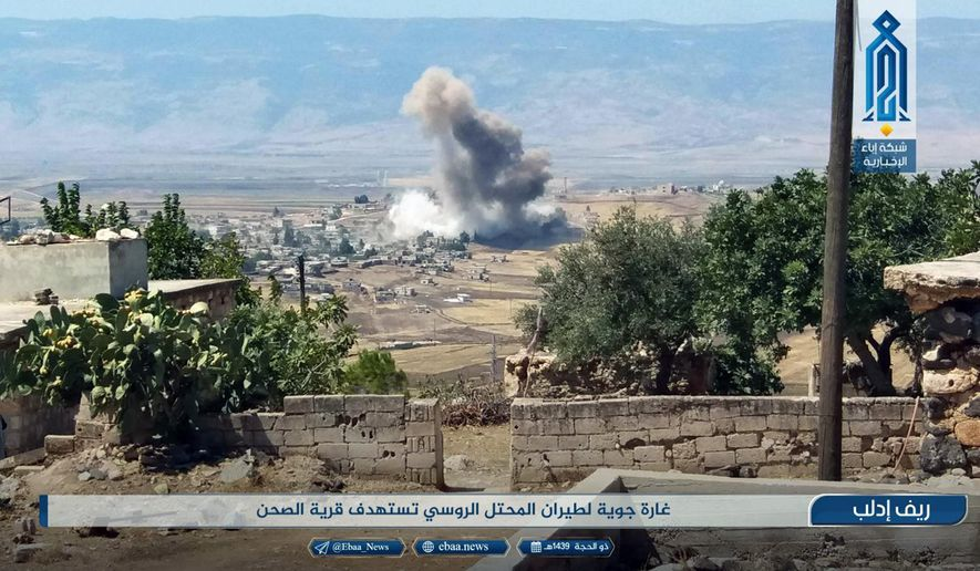 "This photo released Tuesday, Sept 4, 2018 by the al-Qaida-affiliated Ibaa News Agency, shows smoke rising over buildings that were hit by airstrikes, in al-Sahan village, in the northern province of Idlib, Syria. Arabic reads, ""Air raid by the Russian occupation plane targets al-Sahan village."" Despite dire U.S. warnings and fears of a humanitarian disaster, the Trump administration has little leverage to stop Russia, Iran and Syria pressing ahead with a massive military assault against Syria's northwest Idlib province. (Ibaa News Agency, via AP)"