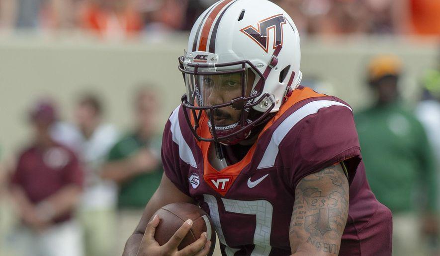 Virginia Tech quarterback Josh Jackson carries the ball against William & Mary during an NCAA college football game Saturday, Sept. 8, 2018, in Blacksburg, Va. (AP Photo/Matt Bell) **FILE**