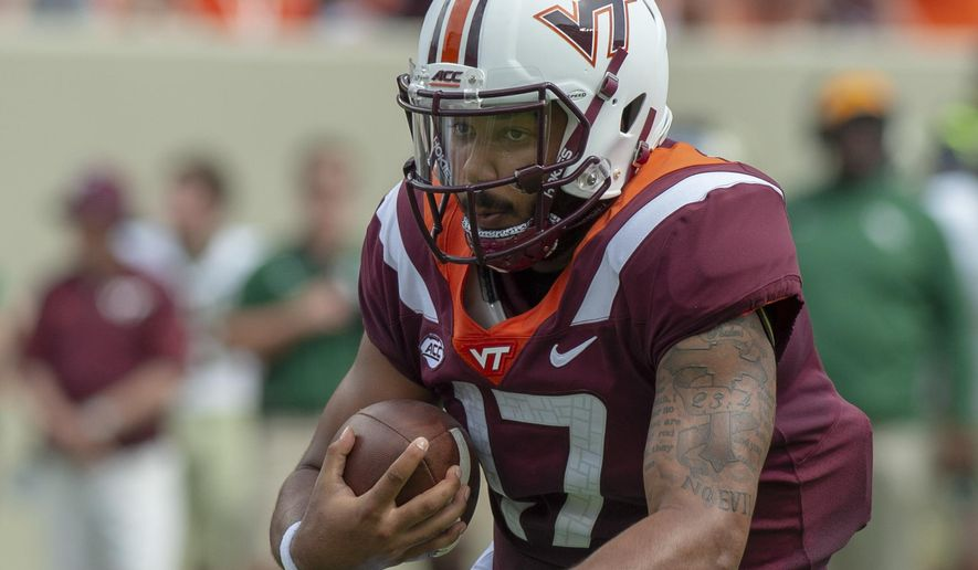 Virginia Tech quarterback Josh Jackson carries the ball against William & Mary during an NCAA college football game Saturday, Sept. 8, 2018, in Blacksburg, Va. (AP Photo/Matt Bell) **FILE**