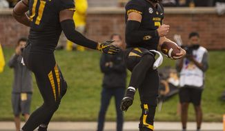 Missouri quarterback Drew Lock, right, celebrates with teammate Kendall Blanton, left, after scoring a touchdown during the first half of an NCAA college football game against Wyoming, Saturday, Sept. 8, 2018, in Columbia, Mo. (AP Photo/L.G. Patterson)