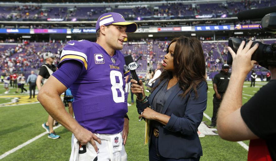 Minnesota Vikings quarterback Kirk Cousins (8) is interviewed after an NFL football game against the San Francisco 49ers, Sunday, Sept. 9, 2018, in Minneapolis. The Vikings won 24-16. (AP Photo/Bruce Kluckhohn)