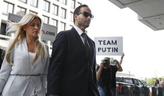 Former Donald Trump presidential campaign foreign policy adviser George Papadopoulos, who triggered the Russia investigation, and who pleaded guilty to one count of making false statements to the FBI, holds hands with his wife Simona Mangiante as they arrive at federal court for sentencing, Friday, Sept. 7, 2018, in Washington. (AP Photo/Jacquelyn Martin)