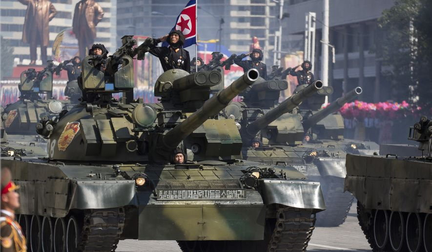 Tanks roll past during a parade for the 70th anniversary of North Korea's founding day in Pyongyang, North Korea, Sunday, Sept. 9, 2018. North Korea staged a major military parade, huge rallies and will revive its iconic mass games on Sunday to mark its 70th anniversary as a nation. (AP Photo/Ng Han Guan)