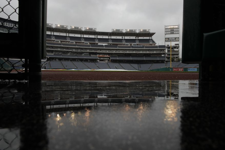 Rain falls on Nationals Park during a rain delay of a baseball game between the Washington Nationals and the Chicago Cubs, Sunday, Sept. 9, 2018, in Washington. (AP Photo/Carolyn Kaster) ** FILE **