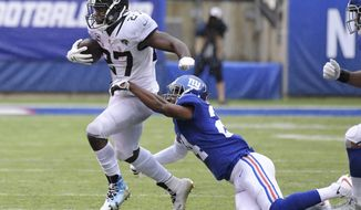 Jacksonville Jaguars running back Leonard Fournette (27) breaks a tackle by New York Giants' Eli Apple (24) during the first half of an NFL football game Sunday, Sept. 9, 2018, in East Rutherford, N.J. (AP Photo/Bill Kostroun) ** FILE **