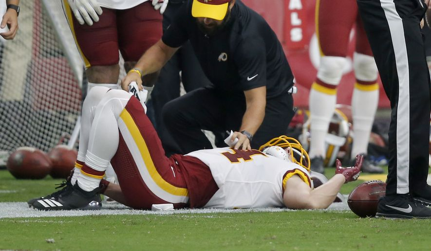 Washington Redskins wide receiver Trey Quinn is injured on the sidelines after a catch against the Arizona Cardinals during the second half of an NFL football game, Sunday, Sept. 9, 2018, in Glendale, Ariz. (AP Photo/Ross D. Franklin)