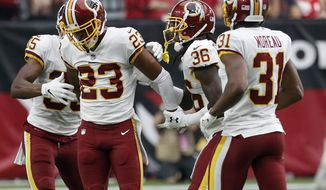 Washington Redskins cornerback Quinton Dunbar (23) celebrates his interception against the Arizona Cardinals with defensive back D.J. Swearinger (36), cornerback Fabian Moreau (31) and defensive back Montae Nicholson (35) during the second half of an NFL football game, Sunday, Sept. 9, 2018, in Glendale, Ariz. (AP Photo/Rick Scuteri)