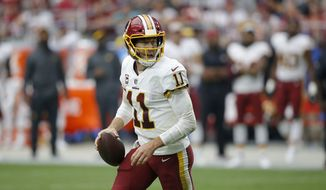 Washington Redskins quarterback Alex Smith (11) runs the football during the first half of an NFL football game against the Arizona Cardinals, Sunday, Sept. 9, 2018, in Glendale, Ariz. (AP Photo/Ross D. Franklin)