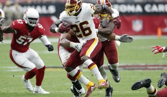 Washington Redskins running back Adrian Peterson (26) runs against the Arizona Cardinals during the first half of an NFL football game, Sunday, Sept. 9, 2018, in Glendale, Ariz. (AP Photo/Rick Scuteri)