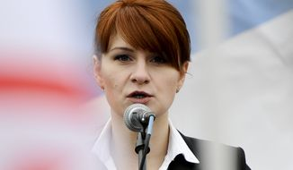 In this April 21, 2013, file photo, Maria Butina, leader of a pro-gun organization in Russia, speaks to a crowd during a rally in support of legalizing the possession of handguns in Moscow, Russia. (AP Photo/File)