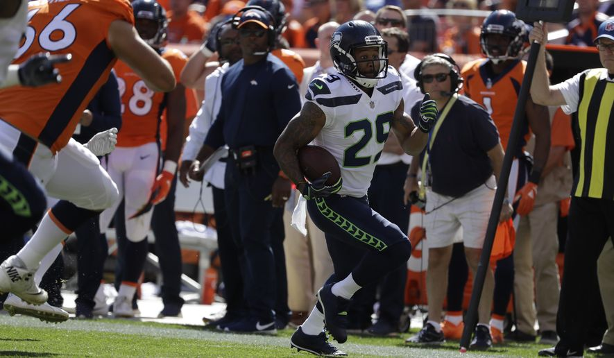 f3d016840c0 Seattle Seahawks safety Earl Thomas intercepts a pass during the first half  of an NFL football