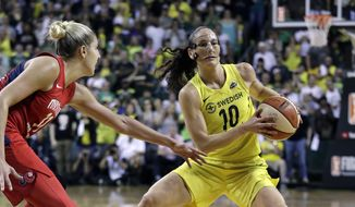 Seattle Storm's Sue Bird (10) moves as Washington Mystics' Elena Delle Donne defends in the second half of Game 2 of the WNBA basketball finals Sunday, Sept. 9, 2018, in Seattle. The Storm won 75-73. (AP Photo/Elaine Thompson) ** FILE **