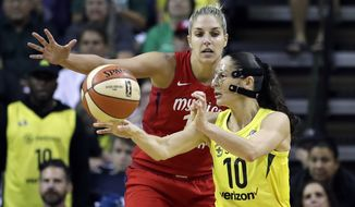 Seattle Storm's Sue Bird (10) passes in front of Washington Mystics' Elena Delle Donne in the second half of Game 2 of the WNBA basketball finals Sunday, Sept. 9, 2018, in Seattle. The Storm won 75-73. (AP Photo/Elaine Thompson) ** FILE **
