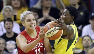 Seattle Storm's Natasha Howard, right, deflects a pass by Washington Mystics' Elena Delle Donne in the second half of Game 2 of the WNBA basketball finals Sunday, Sept. 9, 2018, in Seattle. The Storm won 75-73. (AP Photo/Elaine Thompson) ** FILE **