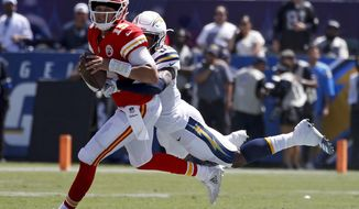 Los Angeles Chargers defensive back Derwin James, right, tackles Kansas City Chiefs quarterback Patrick Mahomes during the first half of an NFL football game Sunday, Sept. 9, 2018, in Carson, Calif. (AP Photo/Kelvin Kuo)