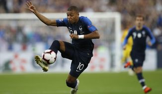 France's Kylian Mbappe controls the ball during the UEFA Nations League soccer match between France and The Netherlands at the Stade de France stadium in Saint-Denis, outside Paris, France, Sunday, Sept. 9, 2018. (AP Photo/Christophe Ena)