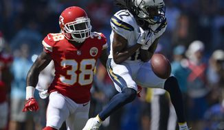 Los Angeles Chargers wide receiver Travis Benjamin, right, drops a pass under pressure form Kansas City Chiefs defensive back Ron Parker during the first half of an NFL football game Sunday, Sept. 9, 2018, in Carson, Calif. (AP Photo/Kelvin Kuo)