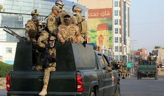 Security forces patrol in Basra, Iraq, 340 miles (550 kilometers) southeast of Baghdad, Saturday, Sept. 8, 2018. Iraqi security forces deployed on the streets of Basra on Saturday, a day after protesters in the southern city stormed the Iranian consulate and torched government buildings in violence that rocked the oil-exporting Shiite heartland and sparked alarm across a conflict-weary country. (AP Photo/Nabil al-Jurani)