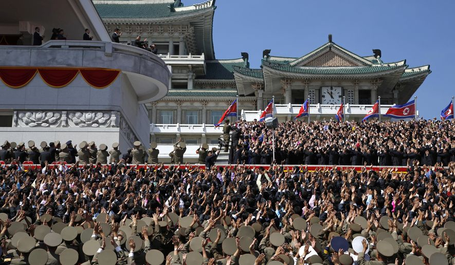 North Korean leader Kim Jong Un, center top left,  waves as he leaves after a parade for the 70th anniversary of North Korea's founding day in Pyongyang, North Korea, Sunday, Sept. 9, 2018. North Korea staged a major military parade, huge rallies and will revive its iconic mass games on Sunday to mark its 70th anniversary as a nation. (AP Photo/Ng Han Guan)
