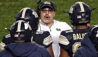 Pittsburgh coach Pat Narduzzi , center, talks with his defense during the first half of an NCAA college football game against Penn State in Pittsburgh, Saturday, Sept. 8, 2018. Penn State won 51-6. (AP Photo/Gene J. Puskar)