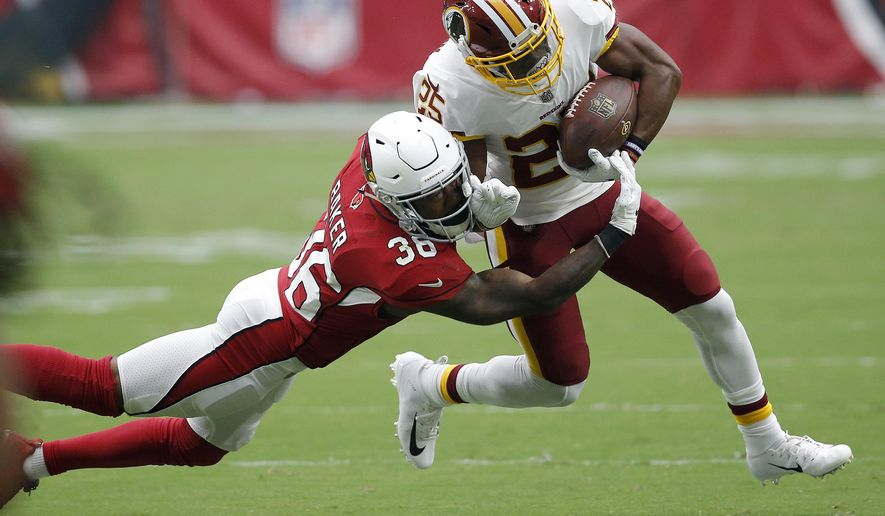Washington Redskins running back Chris Thompson (25) is hit by Arizona Cardinals defensive back Budda Baker (36) during the first half of an NFL football game, Sunday, Sept. 9, 2018, in Glendale, Ariz. (AP Photo/Ross D. Franklin) ** FILE **
