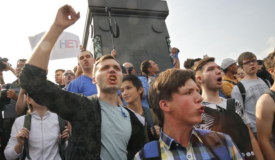 Protesters shout slogans during a rally in Moscow, Russia, Sunday, Sept. 9, 2018. Opponents of a Russian government move to increase the age for collecting state retirement pensions are holding protests throughout the country and scattered arrests have been reported.The protests on Sunday were called by Alexei Navalny, the anti-corruption activist who is President Vladimir Putin's most prominent foe. (AP Photo/Alexander Zemlianichenko)