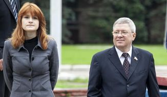 In this photo taken on Friday, Sept. 7, 2012, Maria Butina walks with Alexander Torshin then a member of the Russian upper house of parliament in Moscow, Russia. (AP Photo/Pavel Ptitsin)