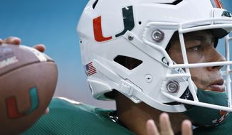 Miami quarterback Malik Rosier warms up for the team's NCAA college football game against Savannah State, Saturday, Sept. 8, 2018, in Miami Gardens, Fla. (AP Photo/Brynn Anderson)