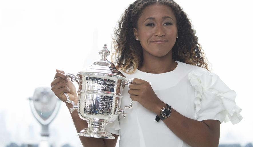 US Open women's singles champion Naomi Osaka poses for photographers with her trophy at Top of the Rock Observation Deck at Rockefeller Center, Sunday, Sept. 9, 2018, in New York. (AP Photo/Mary Altaffer)