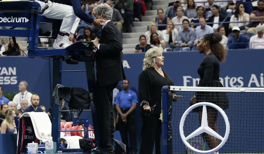 Chair umpire Carlos Ramos, left, talks with referee Brian Earley as Serena Williams talks with Donna Kelso during the women's final of the U.S. Open tennis tournament against Naomi Osaka, of Japan, Saturday, Sept. 8, 2018, in New York. (AP Photo/Andres Kudacki)