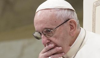 In this Aug. 22, 2018, file photo, Pope Francis is caught in pensive mood during his weekly general audience at the Vatican. Francis' papacy has been thrown into crisis by accusations that he covered-up sexual misconduct by ex-Cardinal Theodore McCarrick. (AP Photo/Andrew Medichini, File)