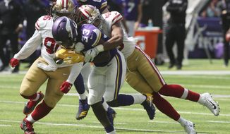Minnesota Vikings running back Dalvin Cook (33) fumbles the ball as he is tackled by San Francisco 49ers linebacker Fred Warner, right, during the first half of an NFL football game, Sunday, Sept. 9, 2018, in Minneapolis. (AP Photo/Jim Mone)