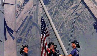FILE--Brooklyn firefighters George Johnson, left,   Dan McWilliams, center,   and Billy Eisengrein, right, raise a flag at the World Trade Center in New York on Sept. 11, 2001. The photo has appeared on T-shirts, buttons and Christmas ornaments.   It hangs at firehouses across the nation. A mural of it was painted on the walls of a Louisiana prison. And copies were left as a calling card in Afghanistan by U.S. commandos.  Many consider it this century's Iwo Jima image, recalling the famous 1945   Associated Press photograph of six American fighting men struggling to raise the flag on Mount Suribachi during World War II..(AP Photo/The Record, Thomas E. Franklin) MANDATORY CREDIT MAGS OUT NO SALES TELEVISION OUT