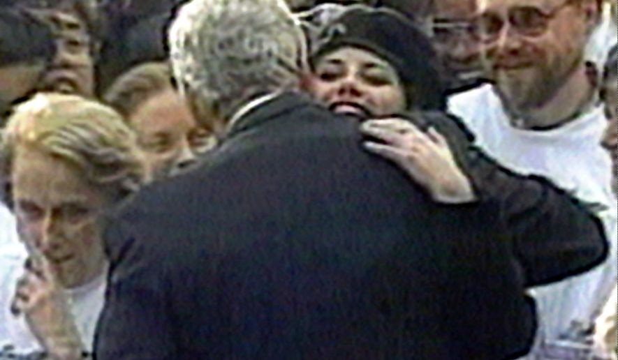 In this image taken from video, Monica Lewinsky embraces President Clinton as he greeted well-wishers at a White House lawn party in Washington Nov. 6, 1996. (AP Photo/APTV)