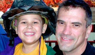 P.J. Schrantz and his young son, Dustin. (Photo courtesy of P.J. Schrantz)