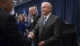 Attorney General Jeff Sessions greets new immigration judges after outlining Trump administration policies, in Falls Church, Va., Monday, Sept. 10, 2018. Immigration judges work for the Justice Department and are not part of the Judicial branch of government. (AP Photo/J. Scott Applewhite)