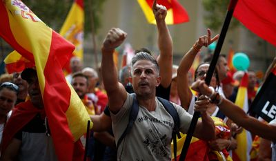 Anti-independence supporters take part during a protest against Catalan secession in Barcelona, Spain, Sunday, Sept. 9, 2018. A few thousand Spaniards are marching in Barcelona in favor of national unity and against the separatist movement in northeastern Catalonia. (AP Photo/Manu Fernandez)