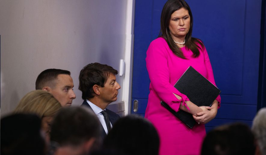 White House press secretary Sarah Huckabee Sanders listens to Kevin Hassett, chairman of the Council of Economic Advisers, speak during the daily press briefing at the White House, Monday, Sept. 10, 2018, in Washington. (AP Photo/Evan Vucci)