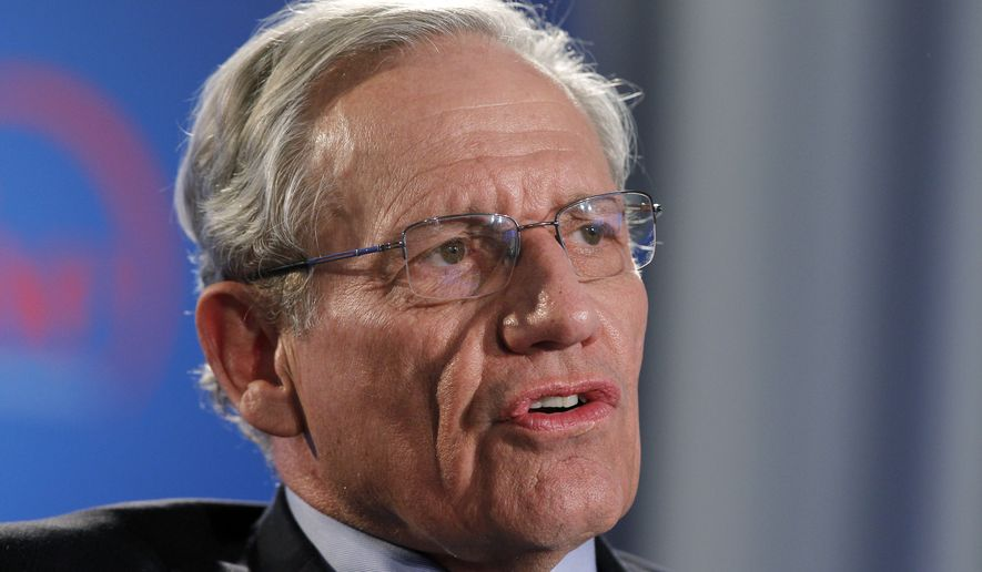 """This June 11, 2012, file photo shows former Washington Post reporter Bob Woodward speaking during an event to commemorate the 40th anniversary of Watergate in Washington. Woodward says top staffers in President Donald Trump's administration """"are not telling the truth"""" when they deny incendiary quotes about Trump attributed to them in his new book. (AP Photo/Alex Brandon, file)"""