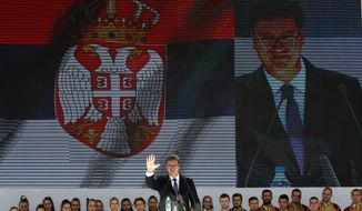 Serbian President Aleksandar Vucic waves to his supporters during a rally in the northern, Serb-dominated part of Mitrovica, Kosovo, Sunday, Sept. 9, 2018. NATO-led peacekeepers in Kosovo say the safety of Serbia President Aleksandar Vucic during a visit to Kosovo isn't threatened despite roadblocks that prevented his visit to a central Serb-populated village. (AP Photo/Darko Vojinovic)