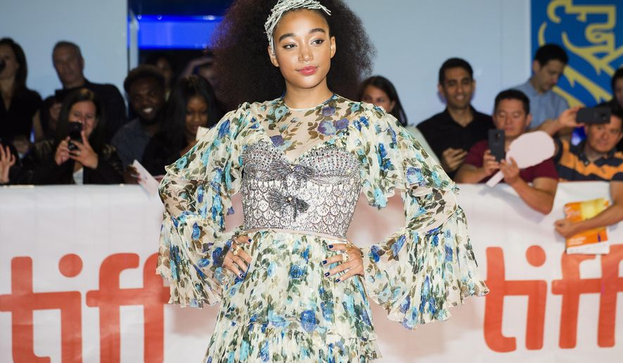 """Actress Amandla Stenberg poses for photographs on the red carpet after arriving for the new movie """"The Hate U Give"""" during the 2018 Toronto International Film Festival in Toronto on Friday, Sept. 7, 2018. (Nathan Denette/The Canadian Press via AP)"""