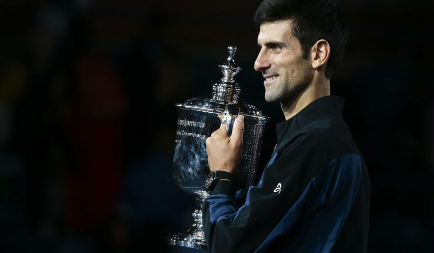 Novak Djokovic, of Serbia, holds the championship trophy after defeating Juan Martin del Potro, of Argentina, in the men's final of the U.S. Open tennis tournament, Sunday, Sept. 9, 2018, in New York. (AP Photo/Andres Kudacki)