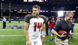 Tampa Bay Buccaneers quarterback Ryan Fitzpatrick (14) walks off the field after defeating the New Orleans Saints in an NFL football game in New Orleans, Sunday, Sept. 9, 2018. The Buccaneers won 48-40. (AP Photo/Butch Dill)