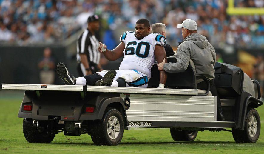 Carolina Panthers' Daryl Williams (60) is taken from the field on a cart after being injured during the second half of an NFL football game against the Dallas Cowboys in Charlotte, N.C., Sunday, Sept. 9, 2018. (AP Photo/Jason E. Miczek)